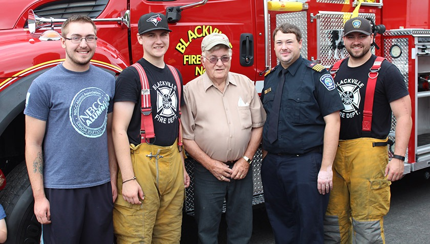 Former firefighter Lewis Donahue with his grandsons Justin Donahue, Austin Kelly, and Christopher and Matt Sturgeon, all of whom are current volunteer firefighters.