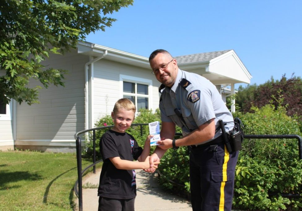 Hunter Linkletter receives a Positive Ticket from Cpl. Jason LeBlanc from Northeast District RCMP Blackville